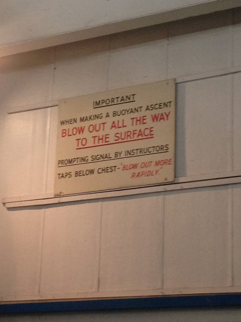 Instructional sign to blow out air at the submarine escape training tower